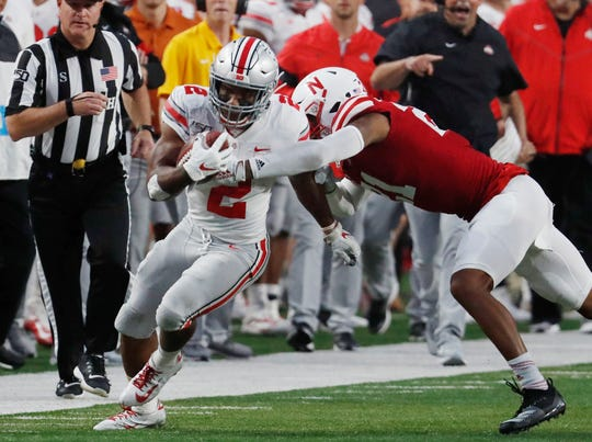 Ohio State running back J.K. Dobbins breaks away from Nebraska Cornhuskers Lamar Jackson during the first half at Memorial Stadium.