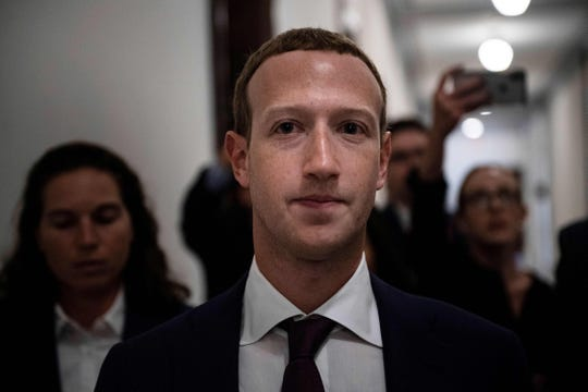 "In this file photo taken on September 19, 2019 Facebook CEO Mark Zuckerberg walks to meetings for technology regulations and social media issues on Capitol Hill, in Washington, DC. - Facebook chief Mark Zuckerberg has pledged to ""go to the mat"" to fight a government attempt to break up the social media giant, according to a report on October 1, 2019 based on a leaked audio recording.Tech news site The Verge released leaked audio from a meeting of Facebook employees in July in which Zuckerberg said he would challenge a breakup effort, repeating his argument that splitting the company would not address issues raised by critics."