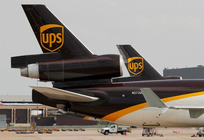 In this June 24, 2019, photo a UPS aircraft taxis to its hangar area after it arrived at Dallas-Fort Worth International Airport in Grapevine, Texas.