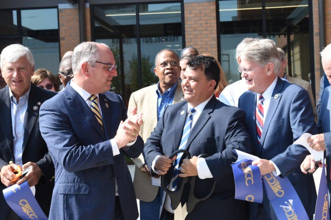 Gov. John Bel Edwards applauds after cutting a grand opening ribbon for the new downtown Central Louisiana Techincal Community College campus with Jimmy Sawtelle (second from right), chancellor of CLTCC; La. Sen. Gerald Long (far left) of District 31; State. Rep. Mike Johnson of District 27; Oliver Overton (back center, Rapides Police juror for District F and a host of other state and local dignitaries.