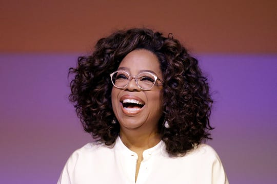 FILE - In this Nov. 29, 2018 file photo, Oprah Winfrey smiles during a tribute to Nelson Mandela and promoting gender equality event at University of Johannesburg in Soweto, South Africa. Winfrey began her career in the mid-1970s as a TV news anchor, moved on to host a talk show for decades and became a media executive and billionaire. Her ability to evolve and remain a force in American culture inspires Shari Coulter Ford, who's also had a long business career and now co-owns Tohi Ventures, maker of Tohi, a beverage sold online. (AP Photo/Themba Hadebe, File)
