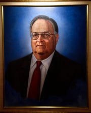 The portrait of former Cooper High School teacher, and former Paramount Theatre board member, Robert Holladay painted by artist Michael Patterson. The painting was unveiled at the Paramount Theatre on Oct. 1.