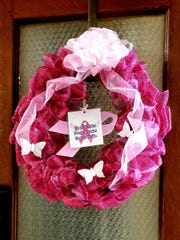 A wreath placed on a door at the 1915 Courthouse, 301 Oak Street, to honor Breast Cancer Awareness Month. Taylor County commissioners and others gathered Tuesday to commemorate the period, which stretches throughout October.