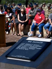 Family members and others at Dyess Memorial Park remember the  317th Airlift Wing airmen Wednesday who died four years ago in Afghanistan Oct. 2, 2019. TORQE 62 was the call sign of a C-130J that crashed in Jalalabad on Oct. 2, 2015, killing six airmen and eight others on board. The memorial at the park is positioned so that it is illuminated by the sun at the precise date and time the accident occurred.