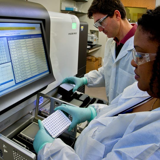 CDC scientists in the Legionella laboratory prepare equipment to perform whole genome sequencing of Legionella pneumophila isolated from environmental samples.