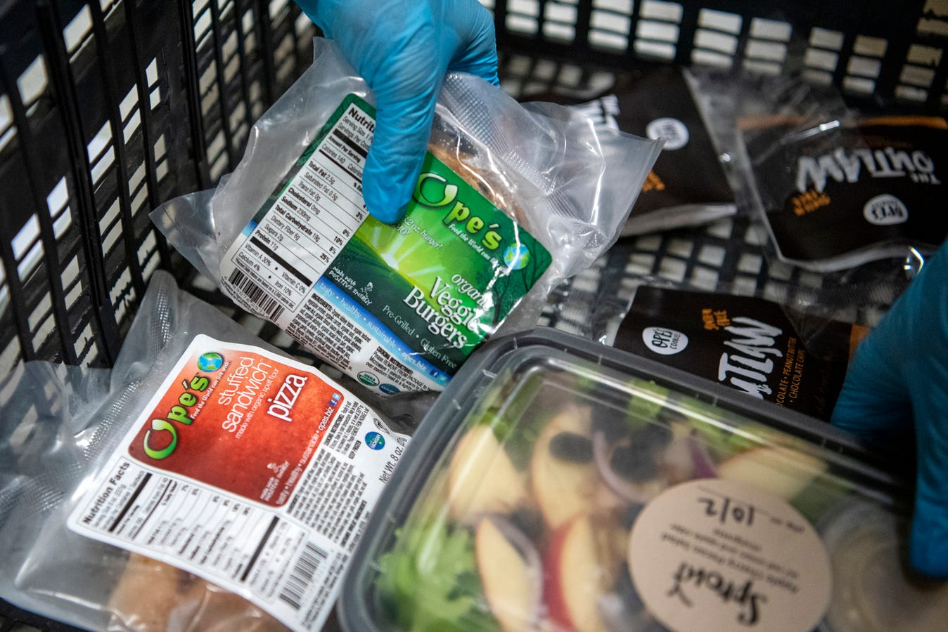 Volunteers assemble grocery orders, some with meat alternatives, on Wednesday, Oct. 2, 2019 at Sprout in Battle Creek, Mich. The nonprofit Sprout sells customized grocery orders of locally sourced products.