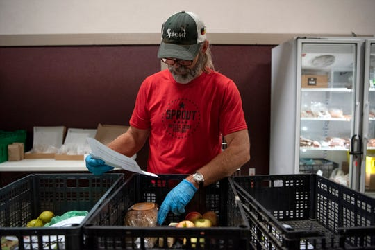 Mark Richards assembles grocery orders, some with meat alternatives, on Wednesday, Oct. 2, 2019 at Sprout in Battle Creek, Mich. The nonprofit Sprout sells customized grocery orders of locally sourced products.