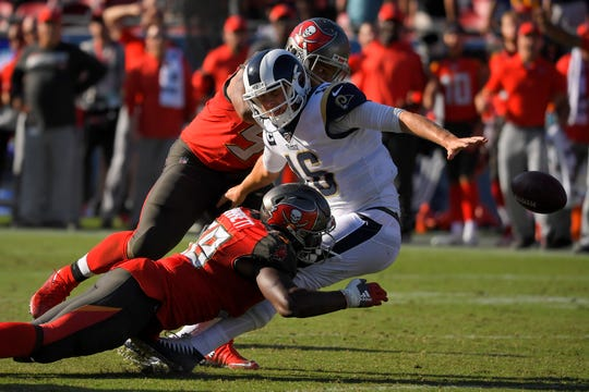 Tampa Bay Buccaneers linebacker Shaquil Barrett forces a fumble by Los Angeles Rams quarterback Jared Goff during the second half of an NFL football game Sunday, Sept. 29, 2019, in Los Angeles. The fumble was returned by a touchdown by the Buccaneers.