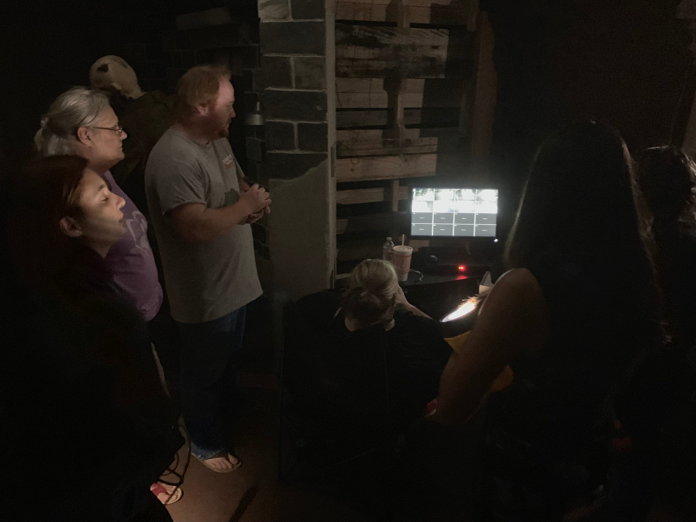 "People gather at the ""command center"" to monitor unusual activity at the Corpus Christi Spook Central's Haunted House on Friday, Sept. 13, 2019."