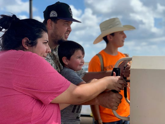 A family uses the apple blaster at Rockin' K Farms in Robstown on Saturday, Sept. 28, 2019.