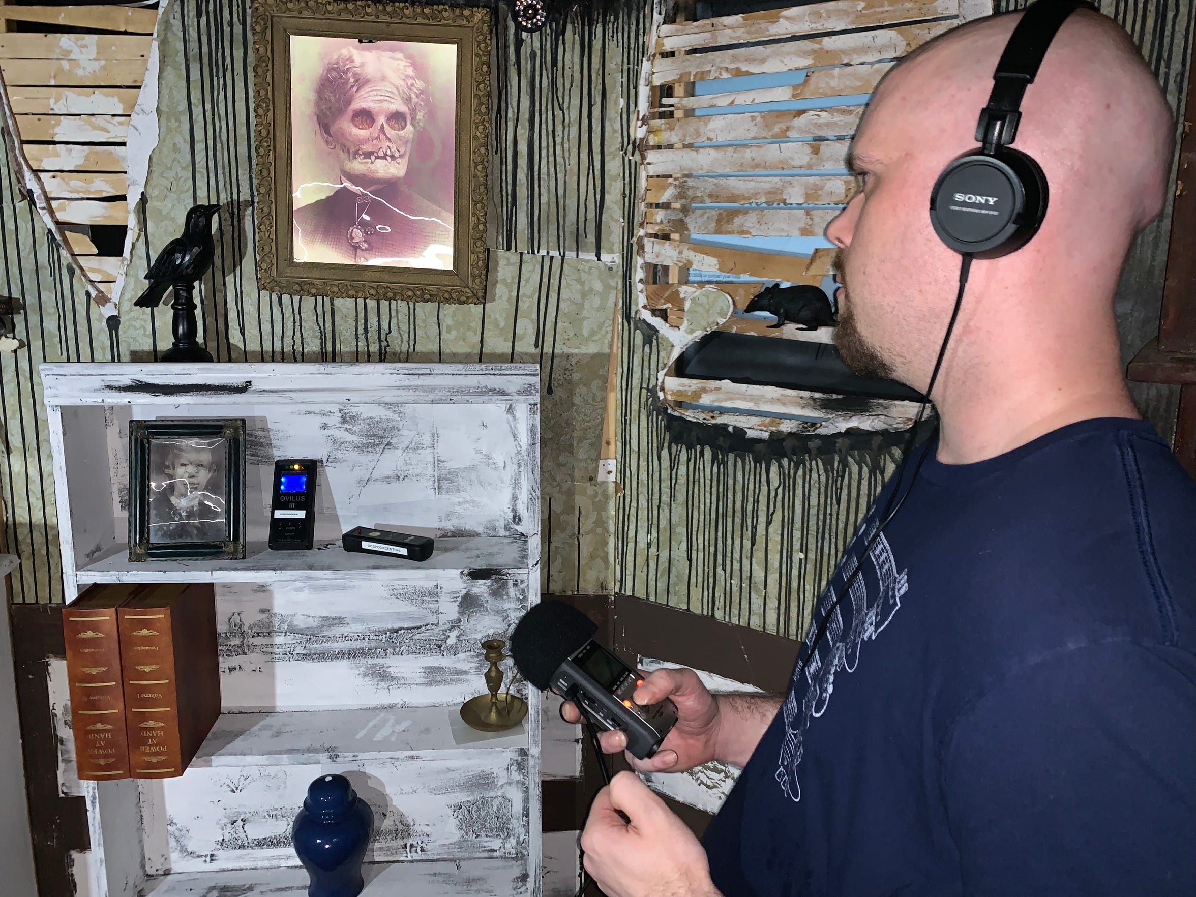 Matthew Scherer uses his personal voice recorder to find paranormal activity at the Corpus Christi Spook Central Haunted House on Friday, Sept. 13, 2019.