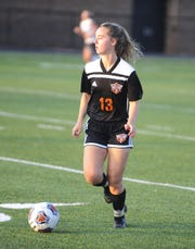 Waverly's Loren Moran dribbles the ball during a 5-0 win over Minford on Tuesday, Oct. 1, 2019 at Waverly High School in Waverly, Ohio.