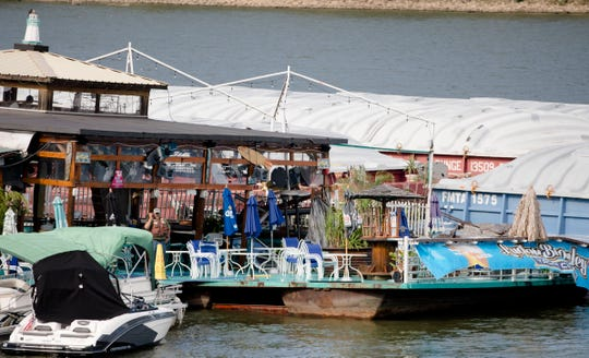 Emergency personnel investigate on the Ludlow Bromley Yacht Club bar as it is adrift in the Ohio River after a barge struck the Ludlow Bromley Yacht Club  in Ludlow, Ky., on Wednesday, Oct. 2, 2019.