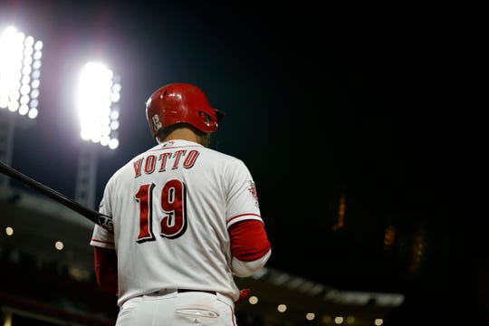 Cincinnati Reds first baseman Joey Votto (19) prepares in the on-deck circle in the ninth inning of the MLB National League game between the Cincinnati Reds and the Pittsburgh Pirates at Great American Ball Park in downtown Cincinnati on Tuesday, July 30, 2019. The Pirates won 11-4.