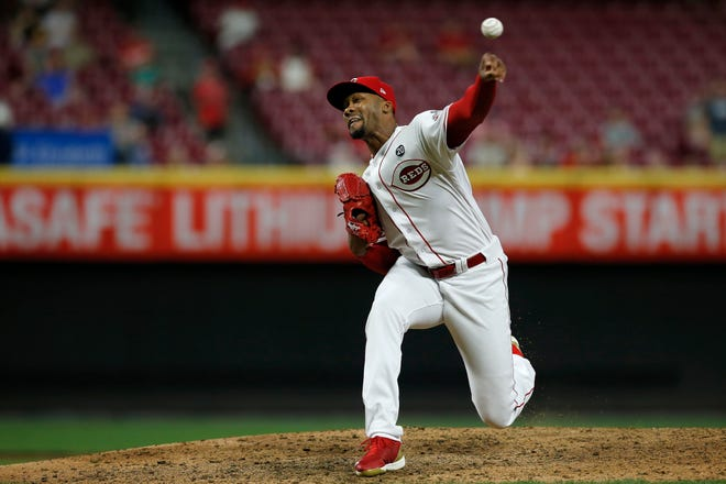 Cincinnati Reds relief pitcher Amir Garrett (50) delivers a pitch in the ninth inning of the MLB National League game between the Cincinnati Reds and the Pittsburgh Pirates at Great American Ball Park in downtown Cincinnati on Tuesday, July 30, 2019. The Pirates won 11-4.
