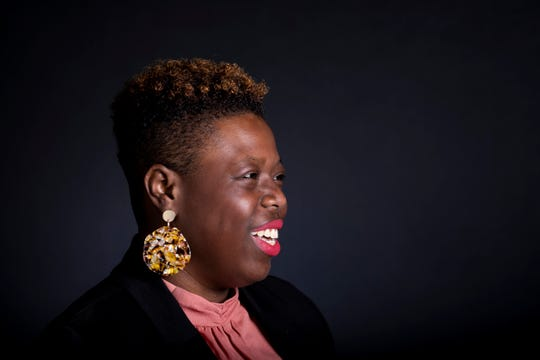 Jasmine Coaston, director of community affairs for city council member P.G. Sittenfeld poses for a portrait in The Enquirer's studio Wednesday, October 2, 2019 in downtown Cincinnati. She supports proposed City of Cincinnati legislation that would make it illegal to discriminate against a person with natural hair.
