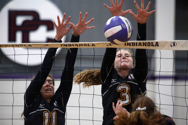 Indianola sophomores Emma Kluver and Lauren Blake throw up a block. Indianola beat Grinnell in three games in an Oct. 1 home meet.