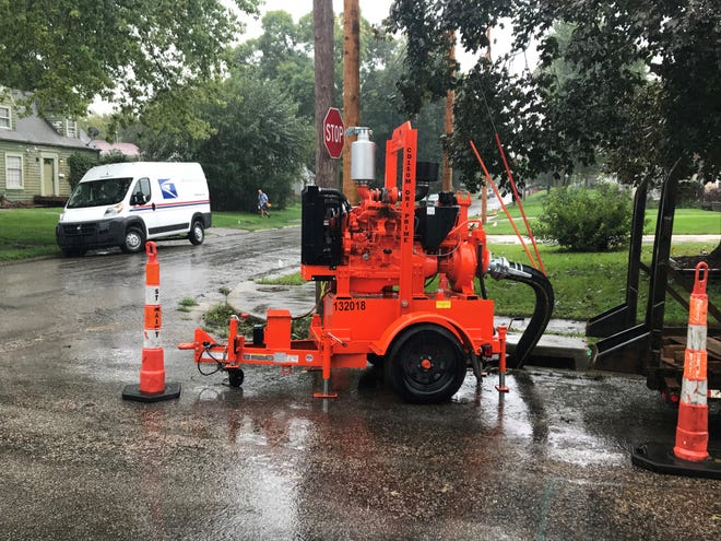 A portable stormwater pump sits at the corner of 47th Street and Holcomb Avenue on Wednesday in Des Moines.