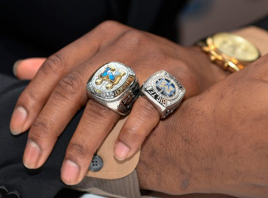 A detail view of the rings worn by Michigan guard Zavier Simpson as he answers a question during the Big Ten conference media day Wednesday, Oct. 2, 2019, in Rosemont, Ill.