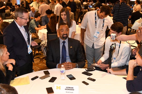 Michigan coach Juwan Howard, center, talks to reporters during the Big Ten conference media day Wednesday, Oct. 2, 2019, in Rosemont, Ill.