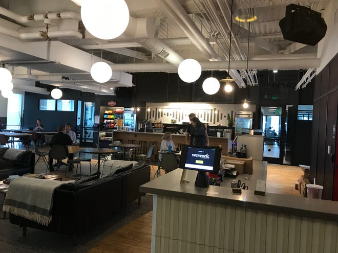 WeWork's office space in the 1001 Woodward office building includes a common area with snack bar and informal meet-up spaces.