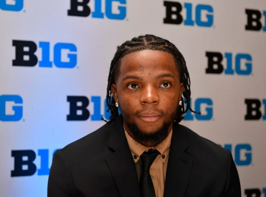 Michigan guard Zavier Simpson answers a question during the Big Ten conference media day Wednesday, Oct. 2, 2019, in Rosemont, Ill.
