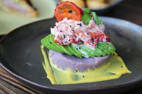 The causa de langosta from Latido at Joebar in Hazel Park is an upscale spin on a traditional Peruvian layered potato salad, featuring avocado and dressed lobster stacked atop avocado slices and purple potato mash.
