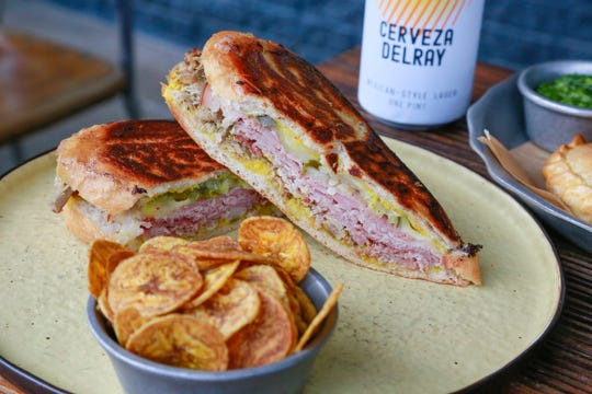 The Cubano sandwich from Latido at Joebar in Hazel Park is served with plantain chips and features smoked ham, confit pork, yellow mustard and McClure's sweet and spicy pickles on Cuban bread.