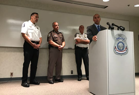 Macomb County Prosecutor Eric Smith discusses the state's new flavored vaping ban with, from left to right, Sterling Heights Police Chief Dale Dwojakowski, Macomb County Sheriff Anthony Wickersham and Clinton Township Police Chief Fred Posavetz at Clinton Township Police Headquarters on Oct. 2, 2019.