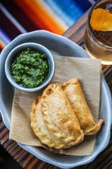 Beef empanadas from Latido at Joebar in Hazel Park contain traditional Argentinian fillings of ground beef, hard-boiled egg and green olives. They're served with a by-the-book chimichurri.