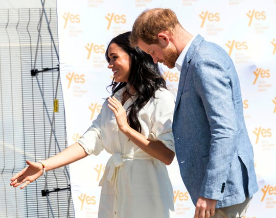 Britain's Prince Harry and Meghan, Duchess of Sussex visit a Youth Employment Services Hub in Makhulong, Tembisa, a township near Johannesburg, South Africa, Wednesday Oct. 2, 2019.