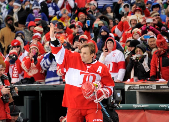 Sergei Fedorov waves to the crowd after being introduced before the Detroit Red Wings vs. Toronto Maple Leafs alumni game at Comerica Park in 2013.