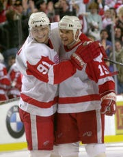 Sergei Fedorov and Steve Yzerman were Red Wings teammates from 1990 until 2003, when Fedorov signed with Anaheim as a free agent. In this photo, Fedorov and Yzerman celebrate Yzerman's overtime winner in a game against the Capitals in 2001.