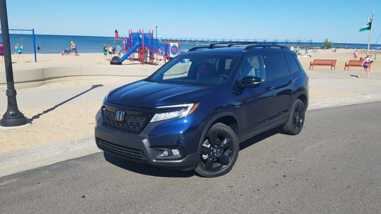 Life's a beach. But the 2019 Honda Passport is for couples whose kids have flown the coop.