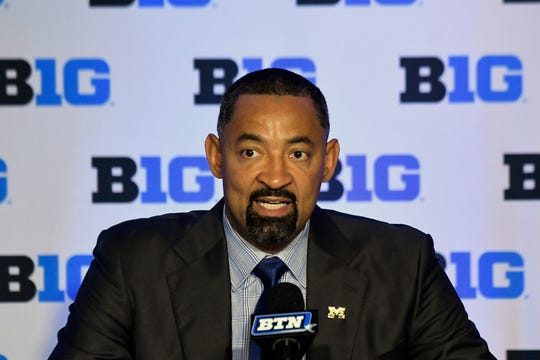 Juwan Howard answers questions during the Big Ten media day Wednesday.