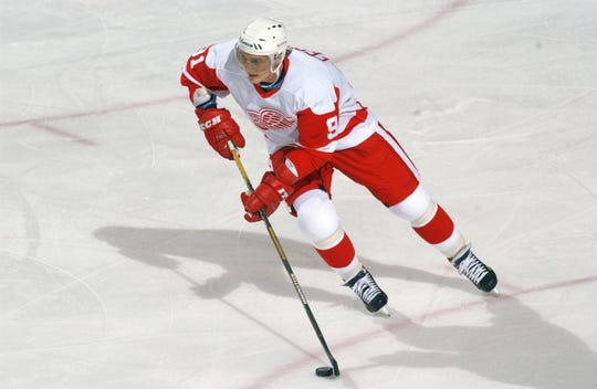 Sergei Fedorov carries the puck in a game against the New York Rangers in 2002.