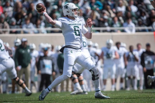 Theo Day, the former Dearborn Divine Child standout, will be one of several vying for the starting quarterback role next season at Michigan State.