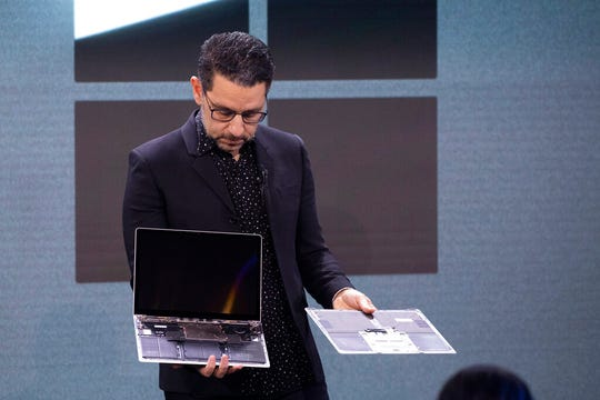 Microsoft's Chief Product Officer Panos Panay shows how the hard drive can be replaced on the Surface Laptop 3 during a Microsoft event, Wednesday, Oct. 2, 2019 in New York.