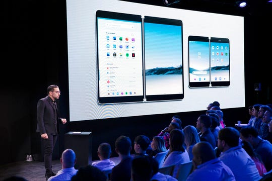 Microsoft's Chief Product Officer Panos Panay discusses the Surface Neo, center, and Surface Duo during a Microsoft event, Wednesday, Oct. 2, 2019 in New York.