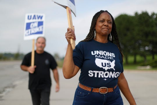 United Auto Workers members picket at General Motors' Orion Assembly plant. Negotiations resumed Wednesday as the national strike against the Detroit automaker extended into a 17th day.