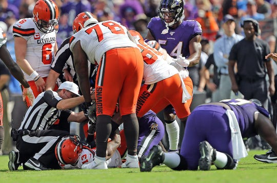 Ravens cornerback Marlon Humphrey and Browns wide receiver Odell Beckham Jr. tussle during Sunday's game.