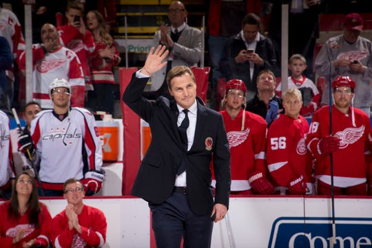 Sergei Fedorov waves to the crowd before a ceremonial puck drop before a game between the Red Wings and Capitals in 2015. Fedorov was inducted into the Hockey Hall of Fame in 2015.