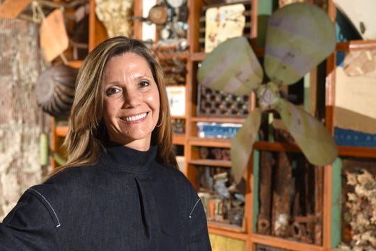 Jennifer Gilbert stands in the offices of Pophouse, the commercial interior design firm she founded in downtown Detroit. After a difficult summer for her family, Gilbert is moving forward.