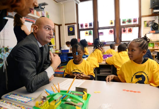 Nikolai Vitti, Superintendent of Detroit Public Schools Community District, interacts with students Burns Elementary students Janylah Mitchell, left, and Marlie Jones, both 6 years old, in their math class on Count Day, Wednesday, October 2, 2019 in Detroit.
