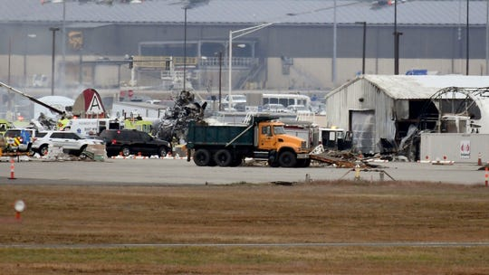 A fire-and-rescue operation is underway where a World War II-era bomber plane crashed at Bradley International Airport in Windsor Locks, Conn., Wednesday, Oct. 2, 2019.