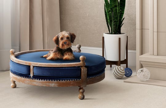 This photo provided by Pottery Barn shows the company's Antique Wood Pet Bed.