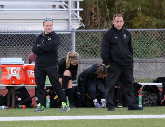 Elmira girls soccer head coach Zach Sarno and assistant Amanda Murphy, left, look on during the team's 2-1 win over Ithaca on Sept. 26, 2019 at Ernie Davis Academy.