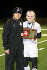 Elmira girls soccer coach Zach Sarno with Sierra Barr after the Express won the 2014 Section 4 Class AA title. Barr is now an assistant for Elmira.