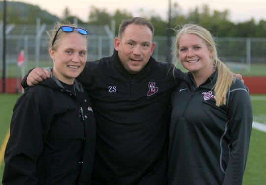 Elmira girls soccer head coach Zach Sarno with assistants Amanda Murphy, left, and Sierra Barr after a 2-1 win over Ithaca on Sept. 26, 2019 at Ernie Davis Academy.