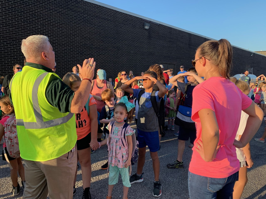 Nearly 90 Stringtown Elementary School participants met at Buehler's IGA parking lot Wednesday for National Walk to School Day.
